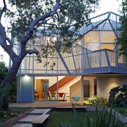 The Palms House in Venice by Daly Genik Architects feels light and airy for a house covered in metal.