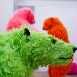 The Galerie Perrotin art gallery in New York City is introducing a kaleidoscope of eight mighty polar bears brightly colored and feathered. They have been frozen in motion, jumping, flying, brawling, snoozing.