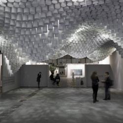 Paper chandeliers by Cristina Parreño.