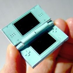 This amazingly detailed papercraft Nintendo DS Lite even has a working hinged case. Templates to make your own provided.