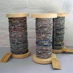From the design studios of Greetje van Tiem comes newspaper yarn.  It can be woven into anything from curtains, to rugs, netting throws, or even upholstery.