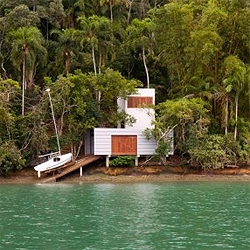 The perfect getaway: tropical jungle, ocean, a boat and a contemporary cabin to enjoy them. Located in Paraty, Brazil, designed by  Gabriel Grinspum & Mariana Simas.