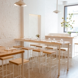 Parish Hall in Brooklyn, NY, with a minimalist restaurant interior, uses simple architectural elements that remain invisible to the diner's overall experience. Designed by Joseph Foglia.
