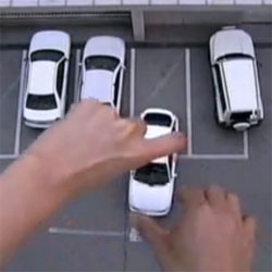 Parking can be tough, but June Bum can give a helping hand. Cute short films in which giant hands seem to conduct the world.