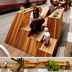 """Interstice Architects Sunset Parklet in SF. The parklet consists of 4 """"strips"""" that undulate along the length of the parklet, providing built-in seating, tables, and native planting, a dog watering area with leash ties, and a built-in bicycle rack and pump station."""