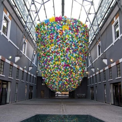 Artist Pascale Marthine Tayou's 10-meter high plastic bag installation at MACRO in Rome through 4/1/13.