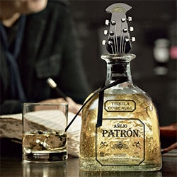 John Varvatos x Patrón Añejo Limited Edition = playful holiday gift pack with Guitar Head Limited Edition Bottle Stopper