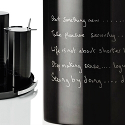 "New limited edition series by Paul Smith for Stelton. ""Statement"" has a collection of messages by the British designer himself, engraved into the black titanium surface to reveal their message in steel."