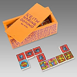 Paul Smith has just launched a  Keith Haring orange wooden domino set printed with colourful pop art characters.