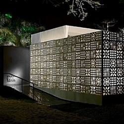 The Patchwork Pavilion  is a temporary structure designed by brazilian architects DOMO. It features a concrete perforated skin that turns it into a lamp during night.