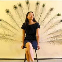 The Peacock Chair's feather automatically open when someone sits down.