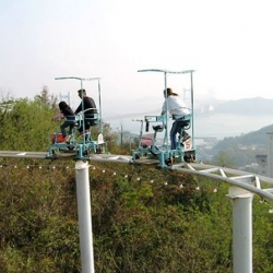 this pedal-powered rollercoaster in japan is pretty awesome.  it's called 'The Skycycle' and is located in Washuzan Highland Park in Okayama