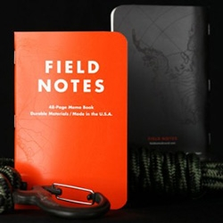 "Field Notes EXPEDITION Edition -  ""Antarctic Survey Orange"" front cover, ""Polar Night Black"" back cover, with a subtle topographic map of Antarctica... and dot grid water- and tear-proof paper extruded from polypropylene pellets!"
