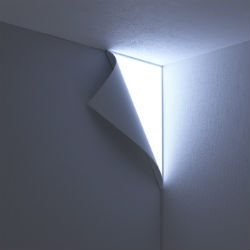 Peel designed by Tokyo based design unit, YOY. The light is meant to look  like the wall paper is peeling off and light is beaming in.