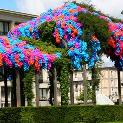 """Pergola"", created by Montréal urban designer Claude Cormier,  is a tribute to Claude Monet - made up of 90,000 plastic balls strung into the trees outside of Le Havre City Hall."