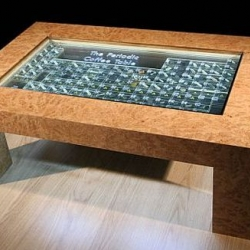 A literal way to display the periodic table at home...as a table.  Complete with actual samples of the elements embedded within the glass.
