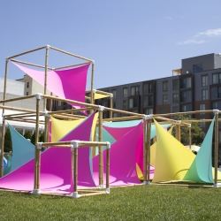 Virginia Melnyk builds a temporary playground of bamboo and fabric. Using parametric generators to organize the fabric and bamboo boxes. The design offers a nondescript way for children and adults alike to play, encouraging more creativity and imagination.