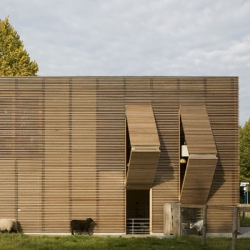 Designed by 70F Architecture, this Petting Farm in Almere, Netherlands is a wooden box with no doors but six shutters, two for the public and four for the animals. A square version of the sheepstable?