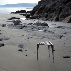 Max Lamb has made a cool exercise in seating by casting two pewter stools directly in the sand on Caerhays beach on the South coast of Cornwall.