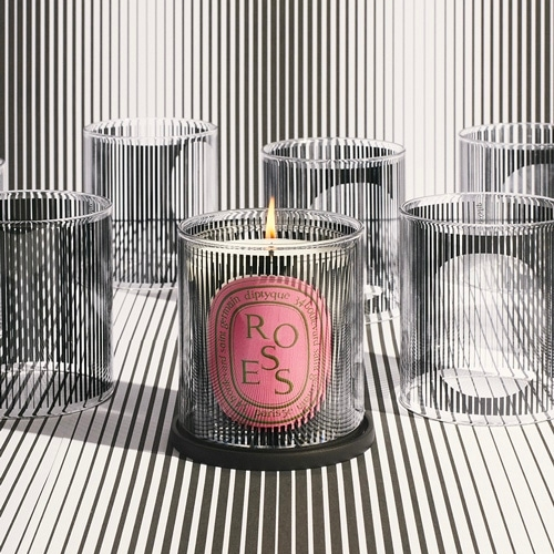 Diptyque Photophore adorned with a thousand black lines will multiply the optical illusions and shadows when you place it over the limited edition Graphic Collection's dancing ovals and rotate it. (hopefully the link for the product page works one day)