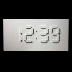 A digital clock with mechanically driven visual elements. Beautifully simple! See the video...