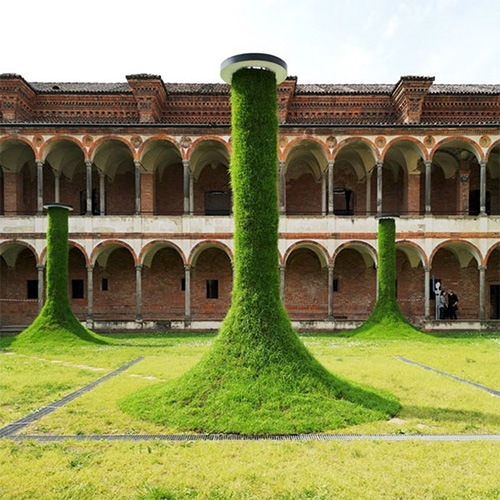 Sleeping Piles installation by Estudio Campana and Apex Brasil for Interni's Human Spaces - Milan Design Week 2019. These grassy conical structures pull you in to relax...
