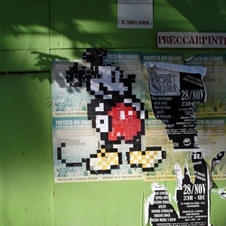 Pixel Mickey, Pixel Naughty Bits, and a bunch more! All cut out of newspaper and stuck up with a brush and wheatpaste. Designed and stuck by Pedro Biz.