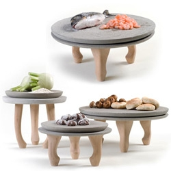 Concrete/wood plates from Nir Meiri look like they're delicately balancing on ballerina toes.
