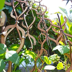 Plant Scaffolding - NOTlabs Laser Challenge #11. The slot fit modular wood pieces can be assembled into various structures. They are held together by friction and zip-ties, and allow you to grow your garden the way you want.