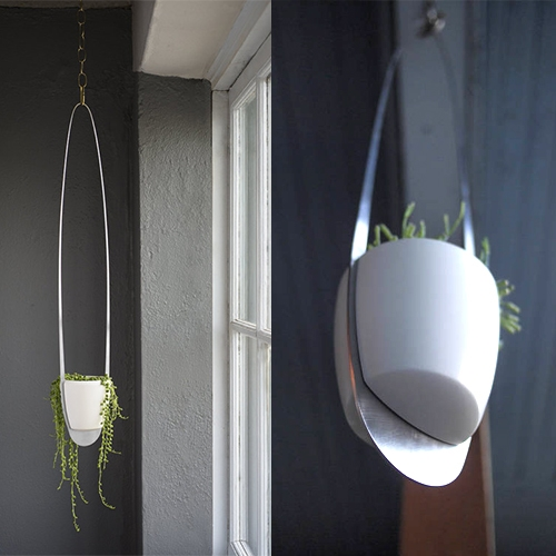 The Groove Ceramic Planter with Modern Metal Hanger by Epekho. A first of its kind design, the Groove gets its name by combining earthenware pottery with a sleek, lightweight stainless steel frame that all snaps together in unexpected ways.