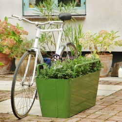 A great-looking alternative to the traditional (ugly) bike rack.  Sexy green planters with built-in rails that can accommodate two bikes!