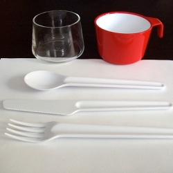Marc Newson tableware for Qantas. The cups are a great example of simple but functional design.