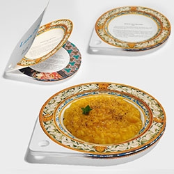 Lunchbook by Sebastiano Ercoli and Alessandro Garlandini - LunchBook is a recipe book made of paper dishes showing recipes from all over the world. Once a dish gets dirty, he can remove it and use the following dish.
