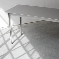 "The minimalistic ""Plus"" table by Goodwin + Goodwin has no screws or bolts, just slots together perfectly and stays sturdy."