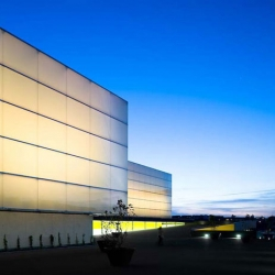 JLCG Arquitectos has designed a beautiful theater and auditorium in the French town of Poitiers. The backlit facade is stunning.