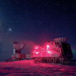 The 10-meter South Pole Telescope and the BICEP (Background Imaging of Cosmic Extragalactic Polarization) Telescope at Amundsen-Scott South Pole Station, against the night sky with the Milky Way.
