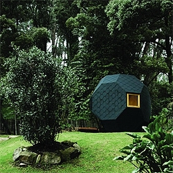 A polyhedron in the middle of a tropical garden in Colombia serves a small retreat to work, read and rest  in the middle of the nature.