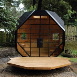 "The ""Habitable Polyhedron"" is a geometric shed tucked away in a garden several yards away from the client's main house that offers a cozy retreat where the family can relax."