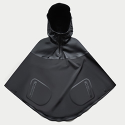 The Arrivals Women's Haring Poncho - Featuring a snap-back peak hood and laser-cut materials. Built from weatherproof poly-spandex shell and rubberized Italian twill made waterproof through heat-welded seams.