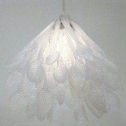 Daisuke Hiraiwa's ethereal recycled spoon chandelier. Each found spoon has been punctured with hundreds of tiny pinholes to create a striking interplay with light.