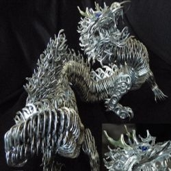"This dragon sculpture was made entirely out of pop tabs, except at the whiskers. The artist has named the 14 inch long and 8 inch high dragon ""shinkonryuu."""
