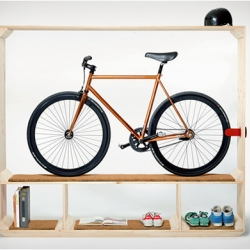 """Shoes Books and a Bike"" by Postfossil, allows you to frame your bike and gives it a deserved place of honor in your apartment....like a trophy in a glass jar."