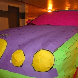 A jaguar covered in post-it notes. It sort of takes the Jaguar into the realm of kiddie toys, what with all the bright colours...