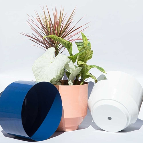 "Outdoor Spun Planters by YIELD. Made from a single piece of metal and powder coated. 16"" diameter."