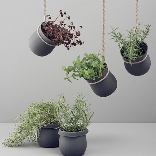Rig Tig Grow It Flower Pots designed by Christian Bjørn. Made of silicone and hemp rope, it has inbuilt drainage and space for extra water at the bottom.