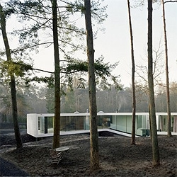 A sleek white villa by the woods, by dutch architects Power House Company.
