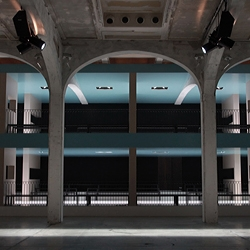 Architect Rem Koolhaas of OMA and Prada have teamed up to create a two-storey catwalk for the Italian fashion label's fall/winter 2011 collection. The catwalk lies within the main exhibition space of the Prada Fondazione in Milan.