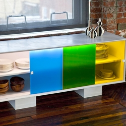 The Primary Series sideboard by Golden Berg Industries uses 2 plexi panel doors that, when opened, creates a third color. In this case the yellow door over the blue door = green door!