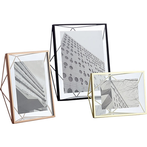 CB2 Prisma Frames - Handcrafted of matte black, gold, or copper powdercoated steel, rods angle a geometric form that freestands vertically or horizontally to float a photo in clear glass.