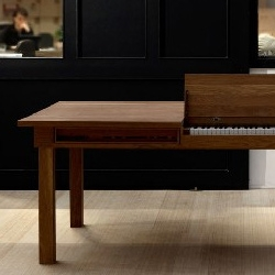 Piano table by Georg Bohle. This dining table comes with an integrated full size electric piano.